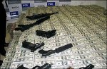 Drug Traffickers Cash and GunsSeized by DEA and Mexican Police in 2007