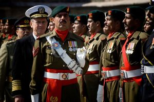 Chairman of the Joint Chiefs of Staff Navy Adm. Mike Mullen reviews Pakistani troops during a ceremony honoring Mullen's arrival to Islamabad, Pakistan, Feb. 9, 2008.
