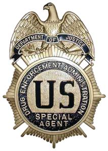 429px-DEA_badge_C