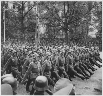 lossy-page1-641px-German_troops_parade_through_Warsaw,_Poland,_09-1939_-_NARA_-_559369.tif